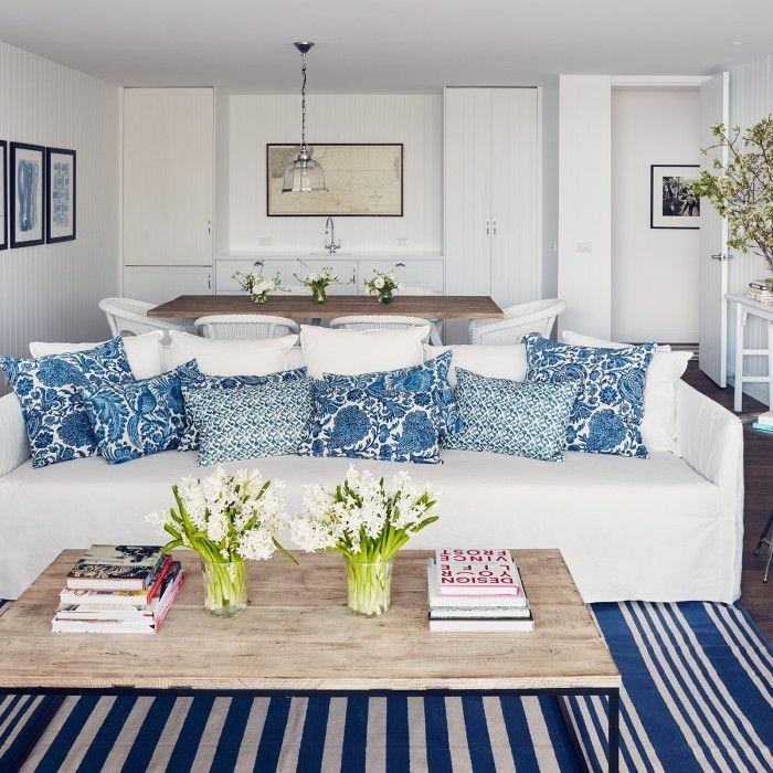 Madeline's Blue Cabana Stripe Cotton Carpet featured in Coastal Living.