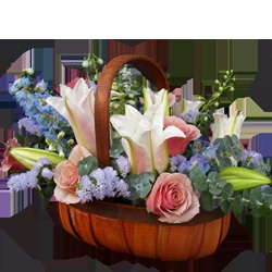 This seasonal basket of fresh cut flowers is a perfect gift for any time of the year.