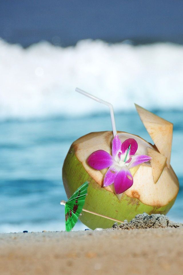 Drinking Coconuts On The Beach