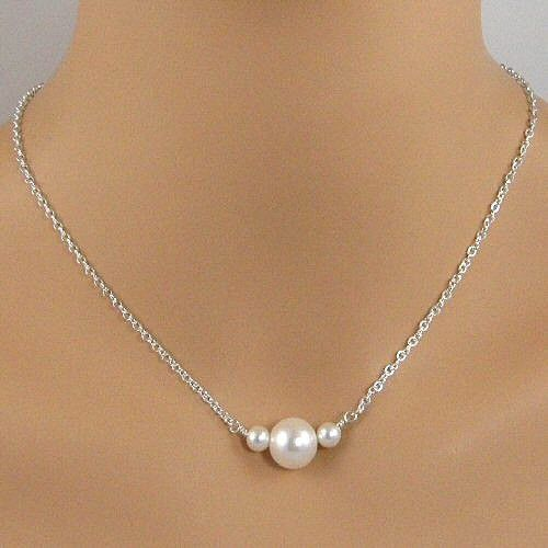 This necklace has a simple yet classy design, two 6mm round pearls with a 14mm white pearl between them. The pearls are suspended from sterling silver chain. BUY NOW http://jewelrybytali.com/products/three-pearl-sterling-silver-chain-necklace-white-pearl-necklace