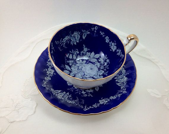 Aynsley Bone China Teacup and Saucer, White Flowers on Cobalt Blue Background, Striking Design