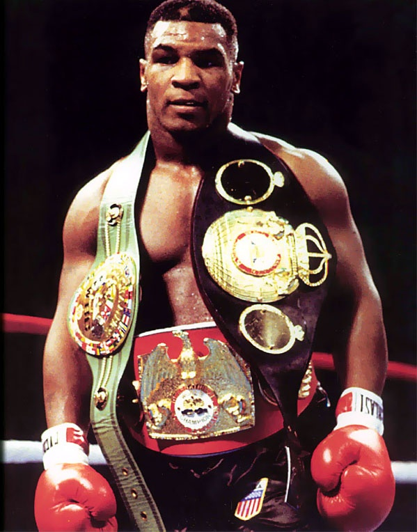 Mike Tyson is the former undisputed heavyweight champion of the world and holds the record as the youngest boxer to win the WBC, WBA and IBF heavyweight titles at 20 years, 4 months, and 22 days old. Tyson won his first 19 professional bouts by knockout, 12 of them in the first round. He won the WBC title in 1986 after defeating Trevor Berbick by a TKO in the second round. In 1987, Tyson added the WBA and IBF titles after defeating James Smith snd then Tony Tucker.