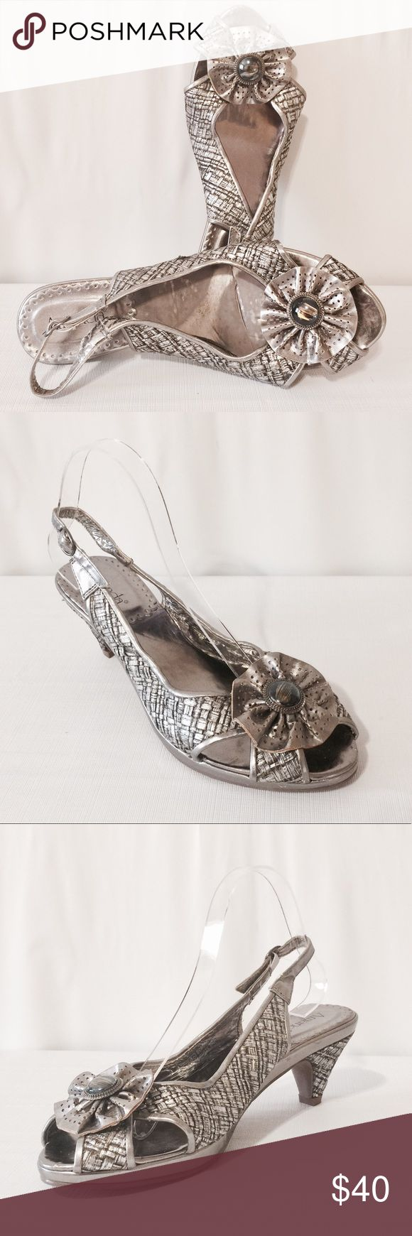 """🔆 Pewter Woven Raffia Sling Back Sandals Stylish and comfortable! Woven pattern trimmed with solid leather, flower accented with smoky topaz center. Man made materials. 1/2"""" platform 3"""" heels. Never worn Amanda Shoes Sandals"""