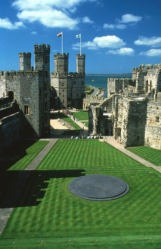 Caernarfon Castle, Wales  a medieval fortress in Caernarfon, Gwynedd, north-west Wales cared for by Cadw, the Welsh Government's historic environment service.