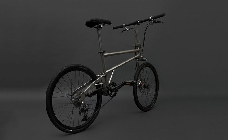Titanium Helix Folding Bike Efficiently Compacts To Its Wheel Size
