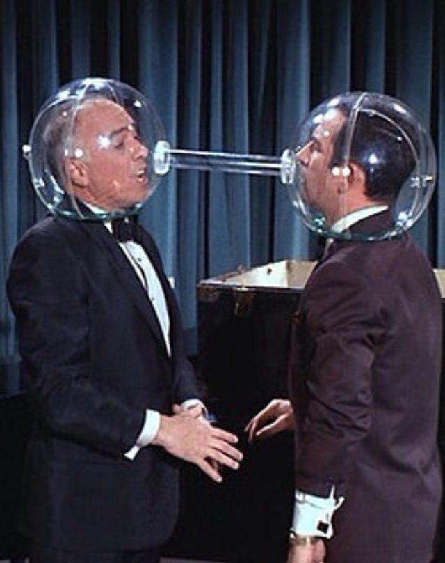 A scene from the Get Smart TV show - Maxwell Smart, Agent 86 (Don Adams) is…