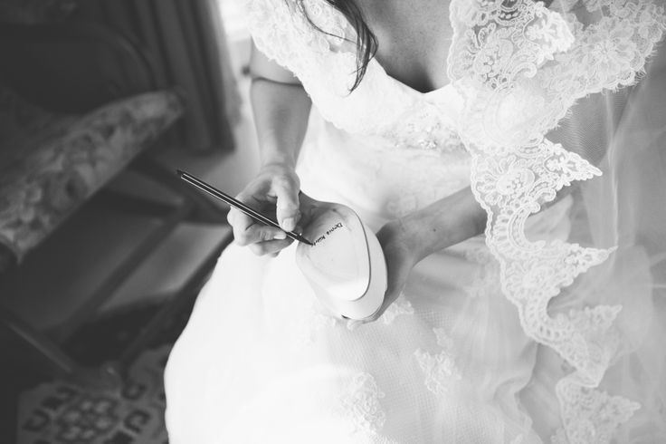 #bride is writing lucky names under her shoe#tradition