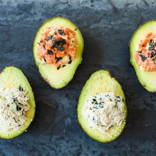 Avocado sushi cups! Stuff avocado cups with your favorite sushi fillings - spicy smoked salmon and crab california roll!