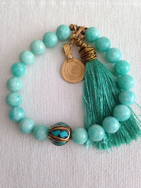 Stunning aqua green semi precious stone bracelet with silk tassel and center bead from Nepal on Etsy, $65.00