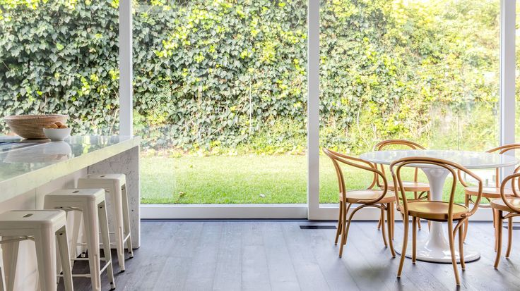 Thonet B9 Le Corbusier arm chairs around Tulip table. Production – Lucy Feagins. Photo – Nikki To for The Design Files.