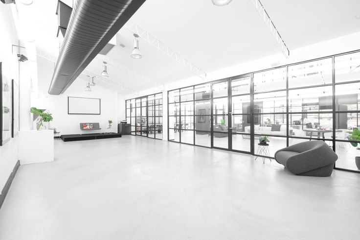 The ultimate creative space.  High ceilings, natural light, glass walls and polished concrete floors.  Floors by Alternative Surfaces Finish: X-Bond BI Colour: Modern Grey Photo: Hugh Davies