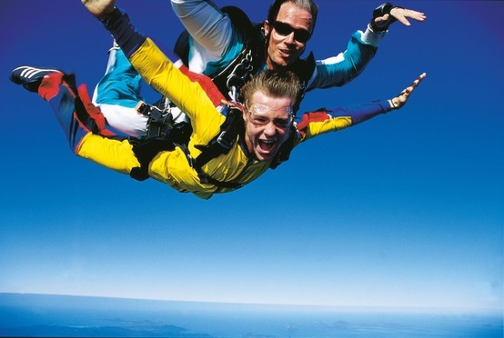 Queensland bucket list | 33. Take the plunge with a tandem skydive and land on the beach.