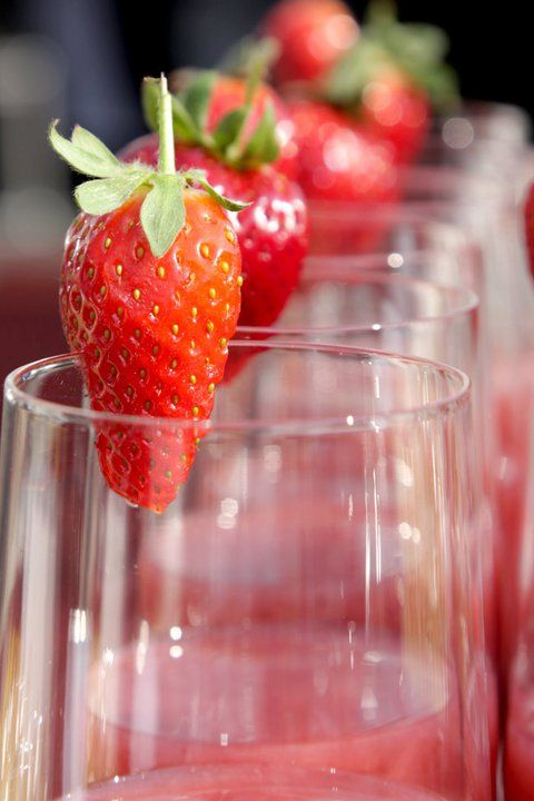Strawberries used as a garnish for cocktails