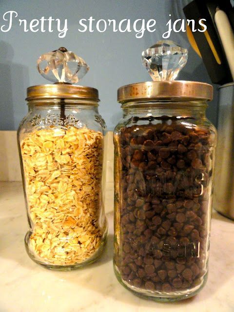 Upcycle sauce jars for pretty storage with glass knobs.----I need something cute to store my chocolate chips in!!