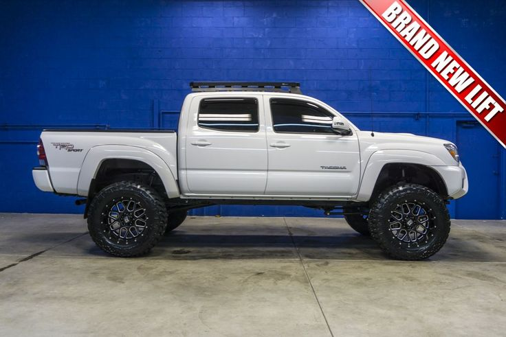 Custom Lifted 2013 Toyota Tacoma TRD Sport 4x4 Pickup Truck with custom wheels and tires for Sale at Northwest Motorsport