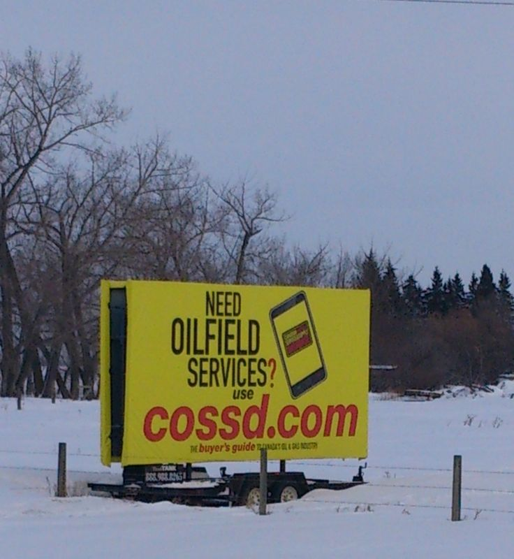 The bright yellow of COSSD's Trailer Billboard stands out against the winter snow, making it highly visible from the highway. #outdooradvertising #billboards #alternativeadvertising #outofhomemarketing
