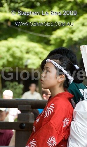 Pretty young Japanese Girl dressed in orange Kimono. Pretty young Japanese Girl waiting to perform on at Yasaka Shrine Stage in Gion district, Kyoto Japan. Photograph By Stephen Le Bas #PeoplePhotography