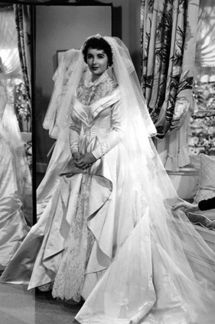 The gown that Elizabeth Taylor wore at her wedding to Conrad Hilton was very similar in design to Costume Designer Helen Rose's creation, which was seen on screen when Taylor played Kay Banks in Father of the Bride in 1950.