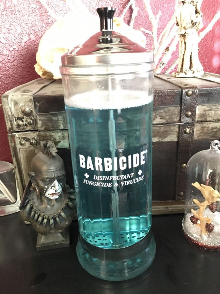 This is a vintage barbershop Barbicide disinfectant jar used to place combs and other tools in to get rid of any creepy crawlies with their own patented Fungicide and Virucide.