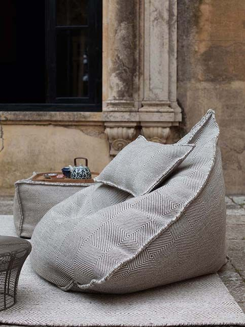 Made of wool, they are warm, comfortable and pleasing to the eye. The weaving of the fabric resembles thickly woven rug. Sail bean bag chairs have interesting cone or triangle shapes. Being thus formed, they do not take random shapes. There are also cubic bean bags which serve as footrests and small tables.