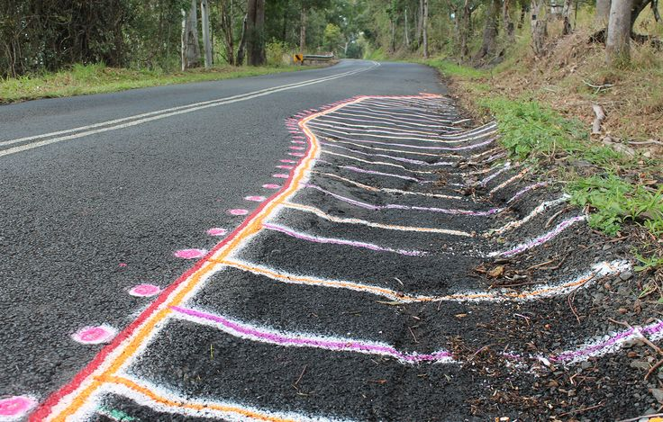 He decided to use the road as Using the road as his own art gallery, a man known only as Roa Dart marks potholes and other road dangers with colourful spray painted designs. His wonderful art is everywhere in the region. Lismore/Nimbin region of Australia.
