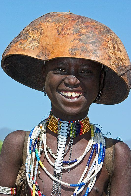Africa |  Portrait of a smiling Erbore girl. Omo valley, Ethiopia | © Johan Gerrits