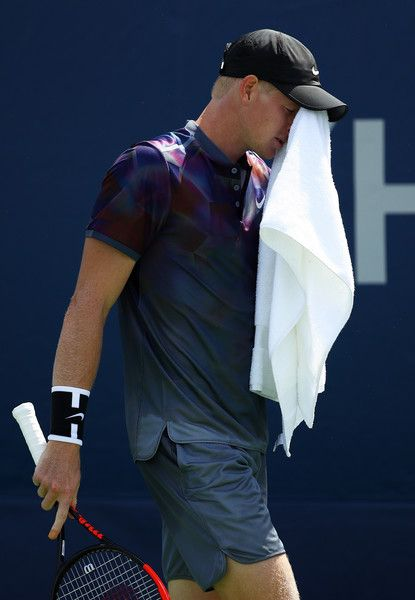 Kyle Edmund of Great Britain wipes his face during his first round Men's Singles match against Robin Haase of the Netherlands on Day One of the 2017 US Open at the USTA Billie Jean King National Tennis Center on August 28, 2017 in the Flushing neighborhood of the Queens borough of New York City.