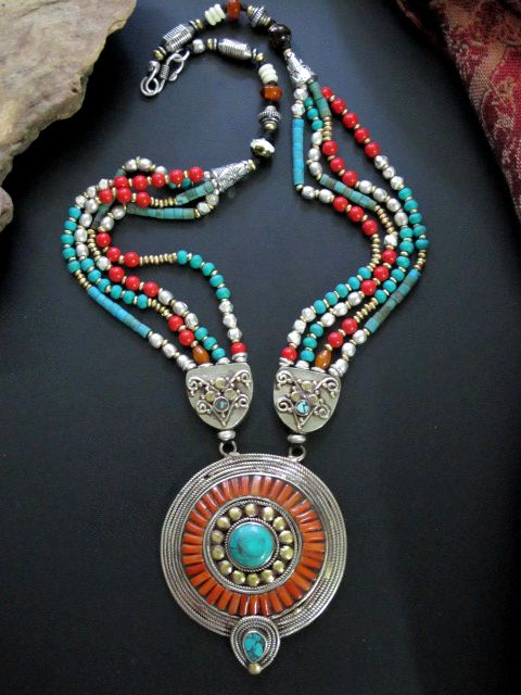 Stunningly beautiful Tibetan Tribal Necklace of Turquoise Red Coral, Bone, and Silver combined with metal. Contemporary well made Tribal Jewelry handcrafted in Nepal.