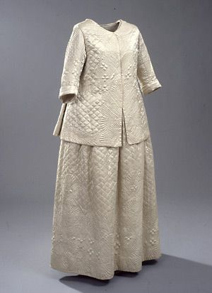 Quilted white caraco (jacket) and skirt (front), Danish, 1770's. The caraco was a hip-length, low-cut jacket or coat with pleats at the back. The sleeves could be short or long, and the shapes and lengths varied greatly. The style came from Nantes in Brittany, and was considered acceptable wear for home life.