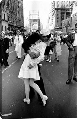 1945- end of world war II. A sailor was so happy he grabbed an unknown nurse in the street ion Times Square and gave her what is quite possibly the most famous kiss of all time during impromptu VJ Day celebration following announcement of the Japanese surrender and the end of WWII. print by Alfred Eisenstaedt at Photos.com 92925887