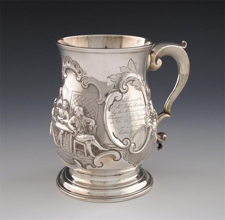 Railway interest: a George II silver mug, by Robert Albin Cox, London 1758, baluster form, leaf capped scroll handle, on a circular foot, later embossed with a tavern scene, within foliate scroll decoration, inscribed ' Presented to Mr John Pountain by the servants in the Passengers' Traffic Department at the Brighton Station as a token of esteem respect',