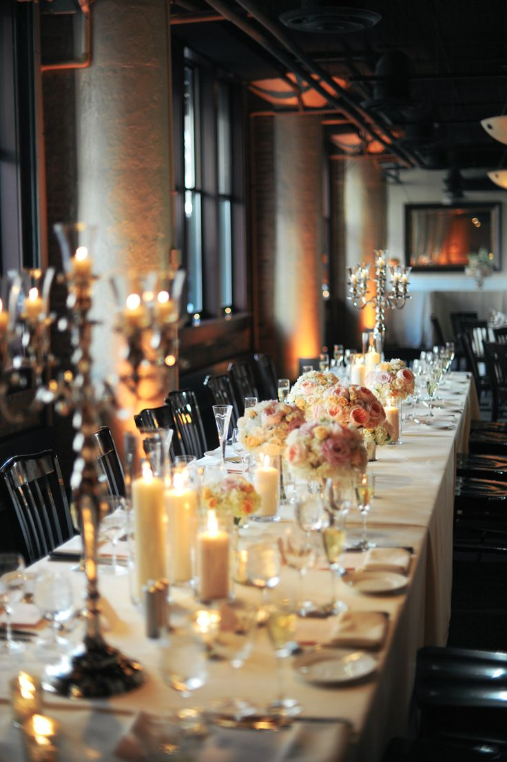 High Candelabras + Low bunches of blooms with candles sprinkled everywhere | Gorgeous | See more on SMP: http://www.stylemepretty.com/illinois-weddings/2013/11/11/modern-chicago-wedding-from-erica-rose-photography | Photography: Erica Rose Photography