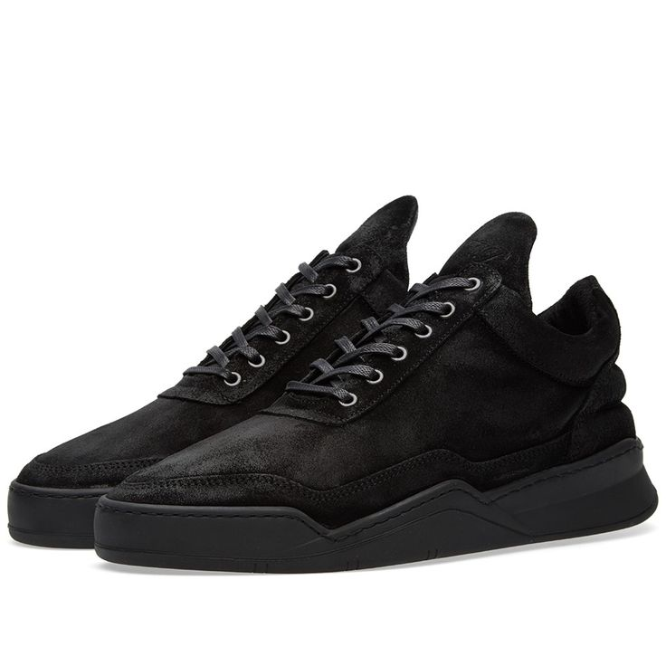 Amsterdam based brand Filling Pieces do exactly what their name intends - fill a gap in the footwear market between street and haute couture, with minimal design and impeccable detailing through high quality product. The Low Top Sneaker is constructed from a premium Italian nubuck, waxed in a matte black, finished with a full leather lining and edge shaped finish on the down strap to ensure a sleek silhouette. The sneaker sits atop a 'Ghost' sole unit.  Italian Leather Uppers Waxed Matte…