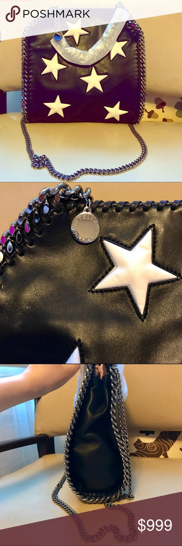 """1 DAY SALE NWT Stella McCartney Falabella ⭐️ Bag This is a gorgeous, mint and 100% authentic Stella McCartney Falabella bag in black w/white stars on one side. It can be worn with the stars or the plain black side showing. This is vegan and a very popular staple for celebrities & fashionistas. This is the mini size with gunmetal chain straps- both tote straps and crossbody. I love this bag but can't afford to keep it, so here's a great chance for you to own this """"it"""" bag. No trades please…"""