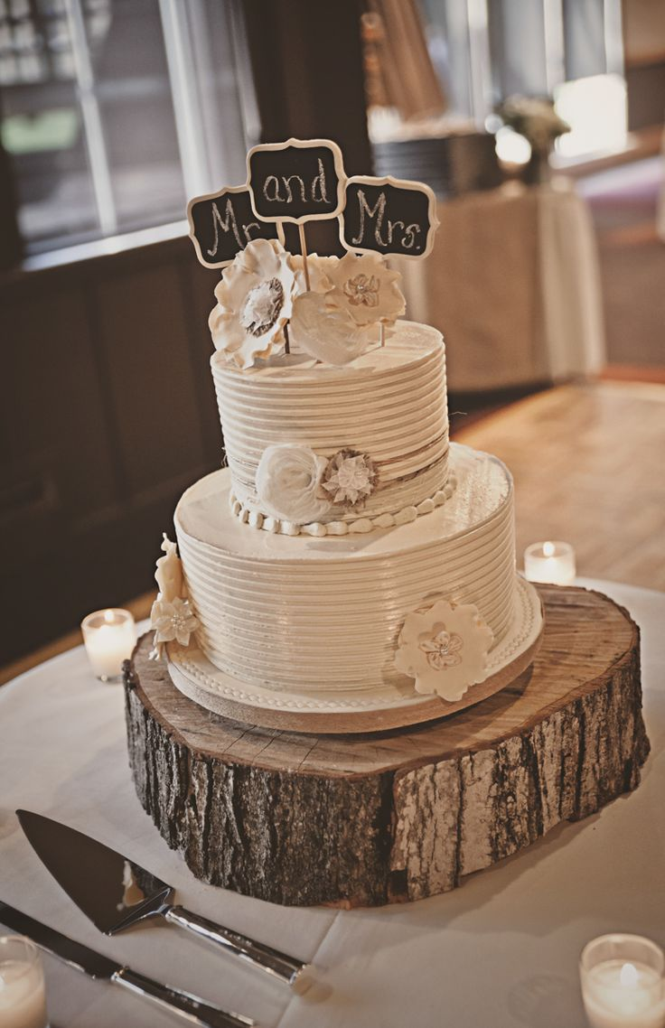Two Tier White Wedding Cake With Chalkboard Cake Topper On