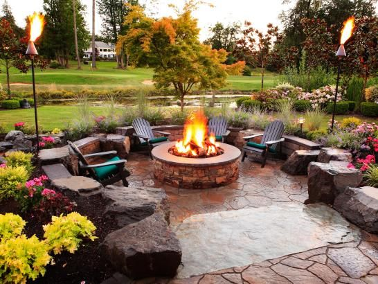 Transitional Patio With Fire Pit and Black Adirondack Chairs