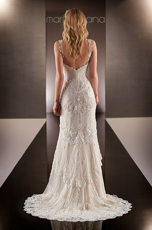 This silk chiffon sheath wedding dress features an overlay of layered scalloped lace down to a sweep train. Martina Liana, Fall 2014