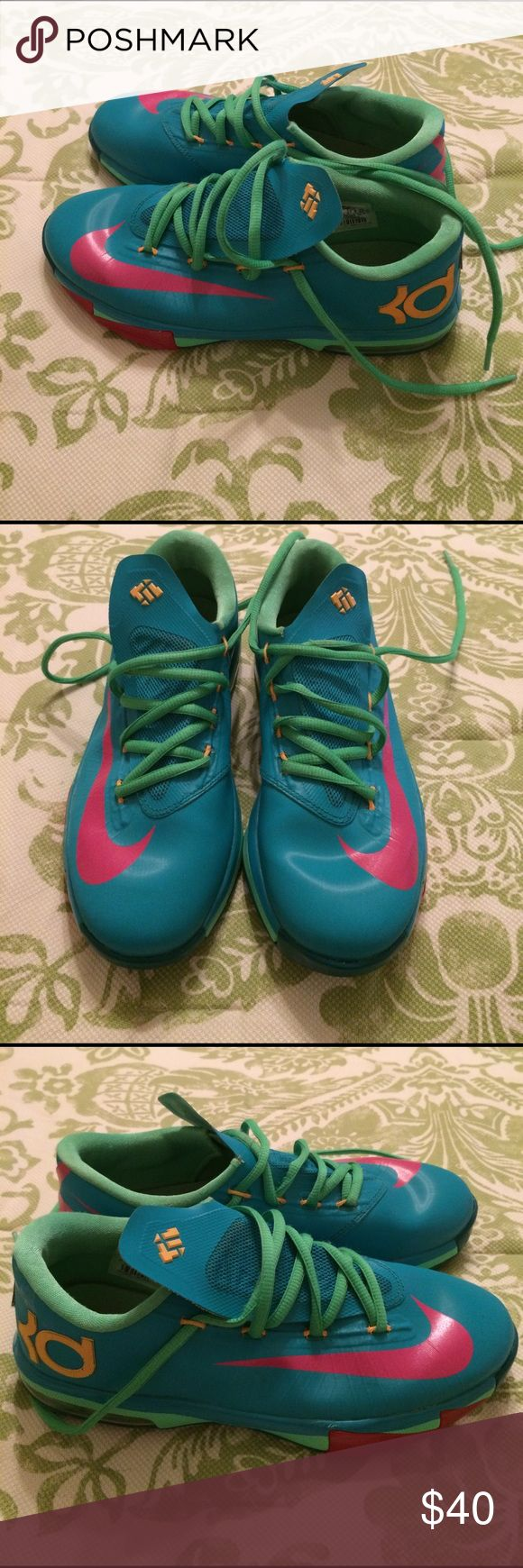 Nike KD shoes size 7 Nike KD shoes size 7 in women's but they are actually a size 5 in girls. In good slightly used condition with minor wear. Only worn a few times. Nike Shoes Athletic Shoes