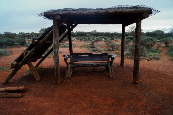 one of the carved wooden benches with shade that we found along the Uluru basewalk
