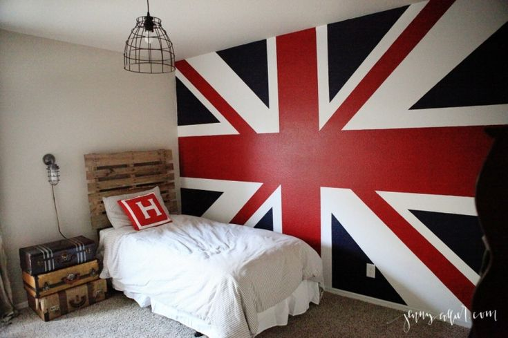 Little Boy's room with a palette headboard, Union Jack wall, vintage suitcases, and more.
