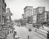 Canal Street in New Orleans circa 1910. Large building is the Maison Blanche department store. ...
