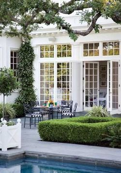 Things That Inspire: Outdoor dining rooms, love the wall of french doors and transoms so beautiful!