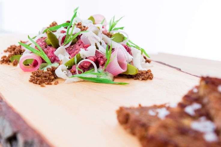 Beef tartare with buttertoasted rye bread, baby mushrooms, pickled shallots, pickles, tarragon mayo and of course lots of love