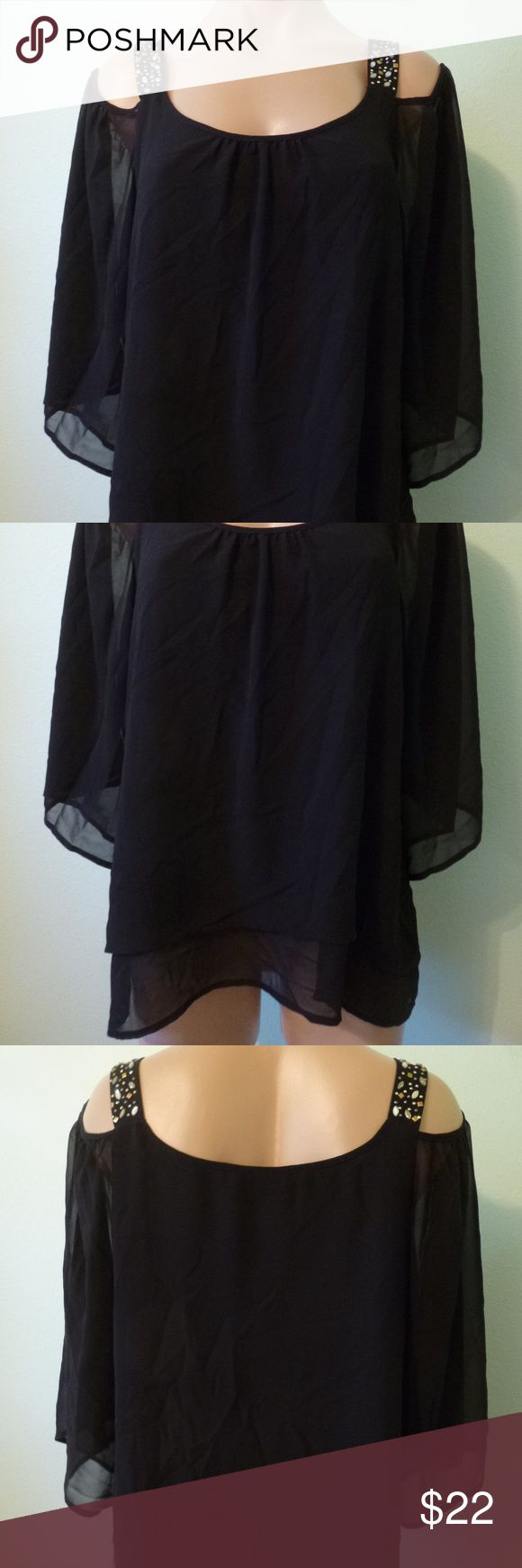 """Thalia Sodi Black Sheer Cold Shoulder Blouse M New Thalia Sodi black sheer crepe blouse over a black lining, size M. Gathered neck and beaded shoulder straps with an off shoulder sleeve. 100% polyester with a stretch poly lining.  Bust 38"""" - 42"""" lining stretched Waist 38"""" Length 25"""" Sleeve 14""""  Item will be shipped within one business day of cleared payment.  Comes from a non smoking home. Thalia Sodi Tops Blouses"""