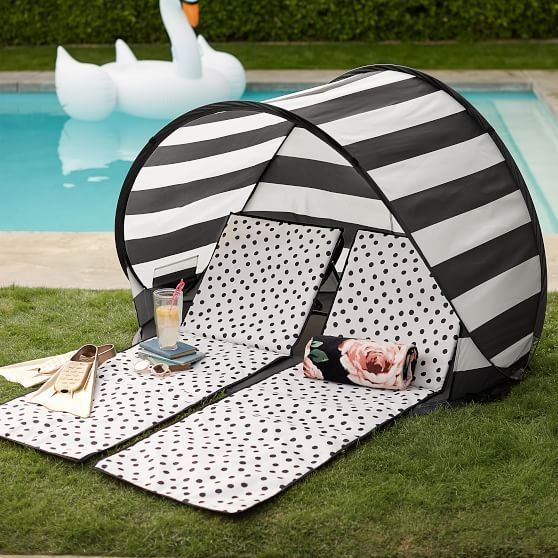 The Emily & Meritt Beach Lounger and Sun Shade Tent: Go ahead, and soak up the sun! Our glam, water-resistant lounger and tent are the ultimate accessories for long days spent relaxing at the beach or pool. Featuring bold, black and white design, they promise enduring durability and style. Imagined exclusively for PBteen by celebrity stylists and fashion designers Emily Current and Meritt Elliott, our lounger and tent capture the duo's classic and rebellious aesthetic.