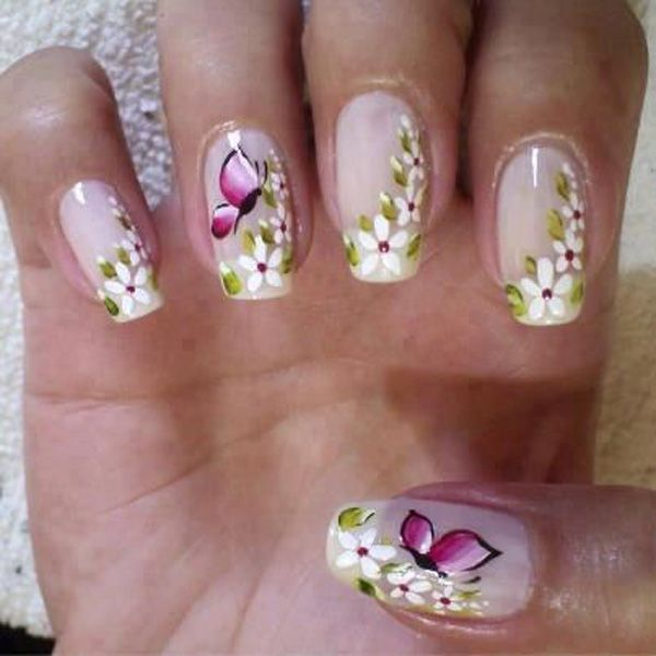 This design is a beautiful and simply elegant butterfly themed design. The white flowers are painted as cascading over the side of the nails while a magenta colored butterfly hovers atop of them.