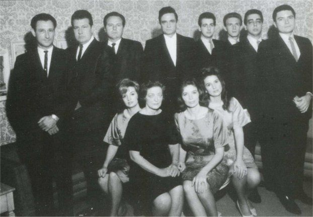 Luther Perkins, W.S. Holland, Marshall Grant, Johnny Cash,   and Statler Brothers Don Reid, Phil Balsley, Harold reid, and Lew DeWitt,   and seated: Helen, Mother Maybelle, June, and Anita Carter.