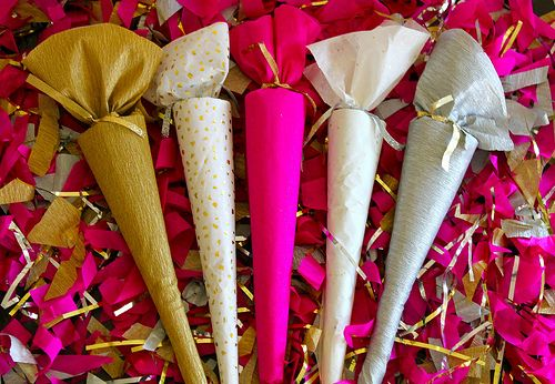 Party favors - create a cone with heavy paper, fill with treats and trinkets, wrap in tissue paper, and secure with a ribbon