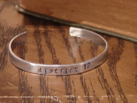 District 12 Silver Bracelet All Hunger Games related items are on sale now for the preparation of the Mockingjay release on November 21st!