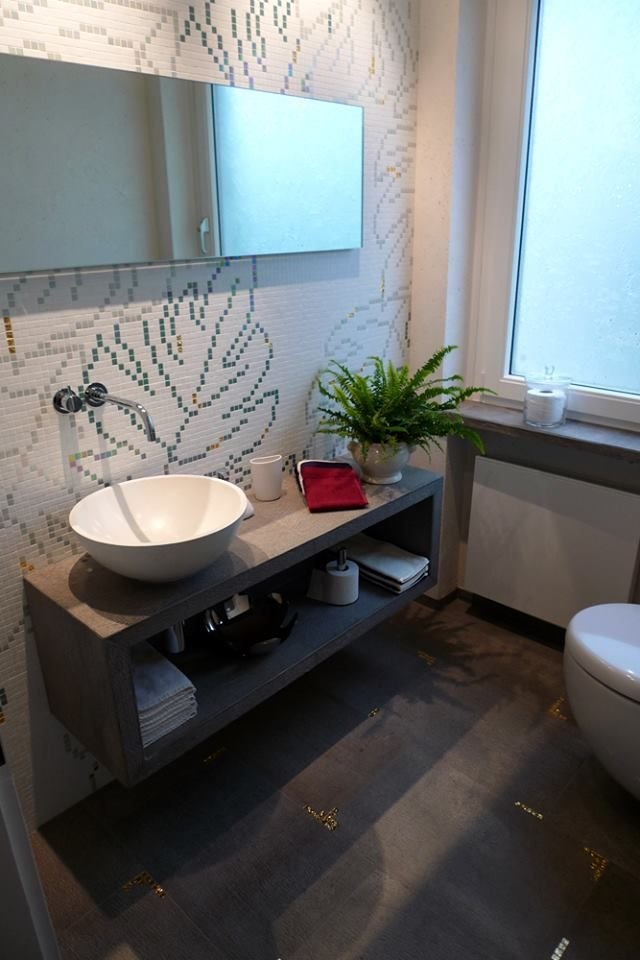 A custom designed decoration with gold tiles inserted on the wall and floor.